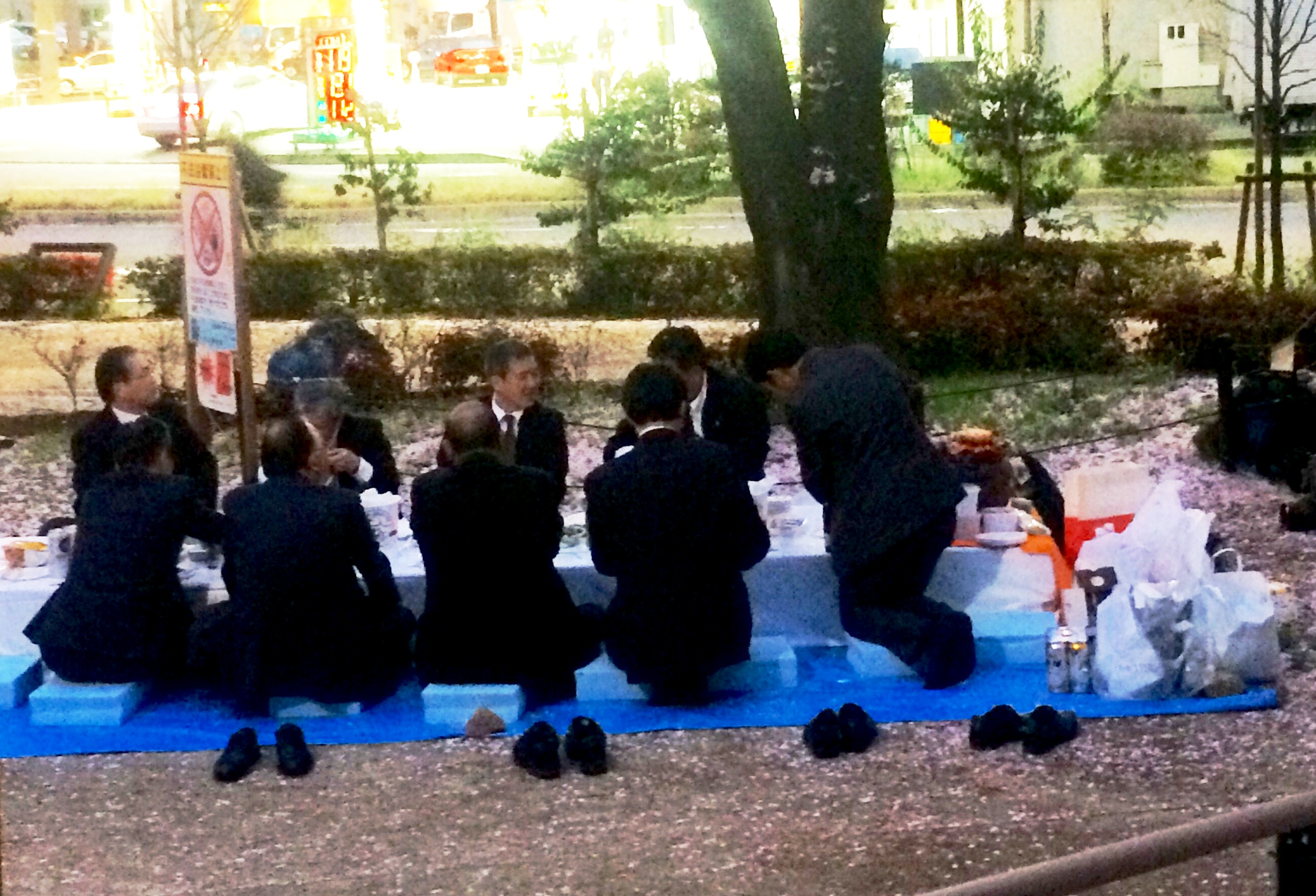Men in suits on picnic by Kirsten Bukager